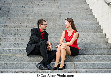 Business people talking in street - Colleagues - young...