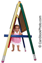 Cute little girl playing on an A-frame
