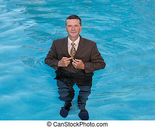 Senior business man in deep water - Senior caucasian...