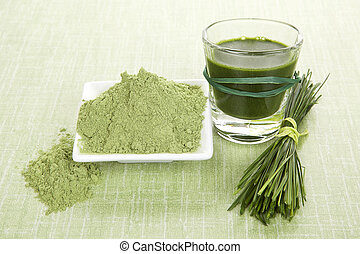 Green food supplements. Green juice, wheat grass powder and...