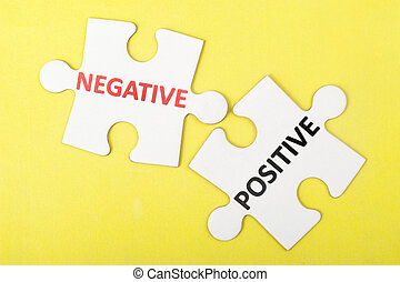 Negative versus positive concept on two pieces of jigsaw...