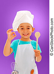 Cheerful little chef showing good taste and wooden spoon