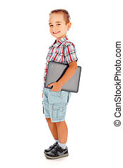 Happy little boy walking with tablet pc