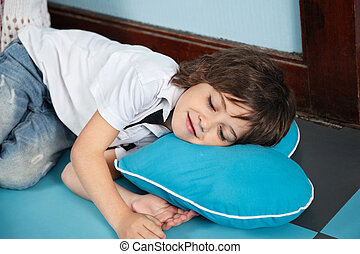 Boy Lying On Heartshaped Pillow In Kindergarten - Cute...