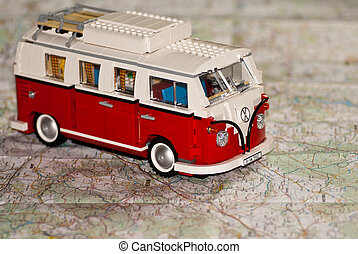 Toy caravan with map background - Conceptual image, vacation...