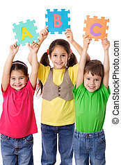 Three kids with letters - Three kids with colorful letters...