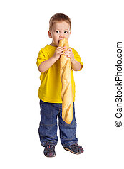 Little boy with french baguette