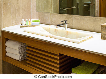 Modern marble wash hand basin in a restroom or hotel...