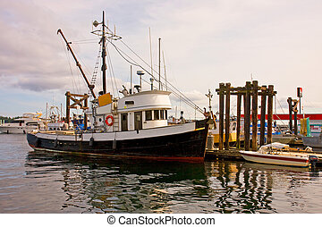 Old Fishing Trawler - An old fishing trawler docked at a...