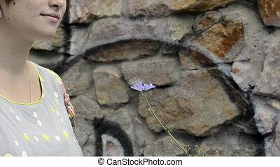 Pregnant girl smelling flower