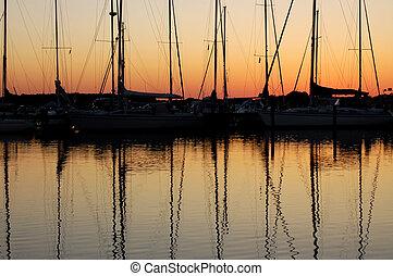 sunset over a marina