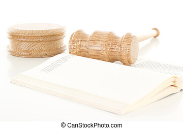 Gavel made of oak wood on open book