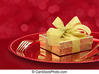 Festive table setting with gift box on a plate