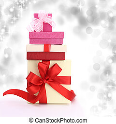 Gift boxes with lights on the background