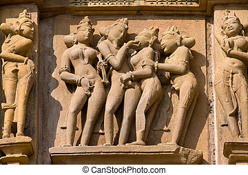 Stone carved temple in Khajuraho, Madhya Pradesh, India -...