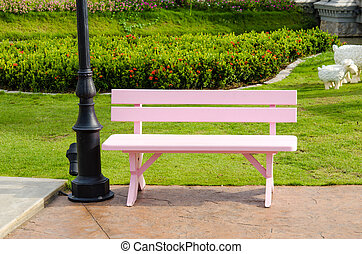 Pink wooden chair.