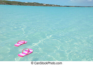 Flip-flops in the water Great Exuma, Bahamas