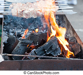 Traditional preparation of a shish kebab on fire closeup