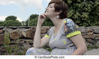 Young pregnant woman sitting