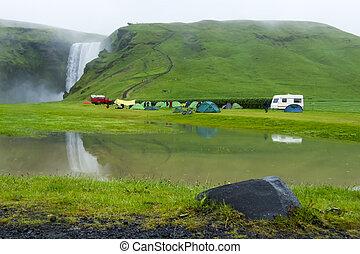 tent camp near Skogarfoss waterfall in Iceland, summer