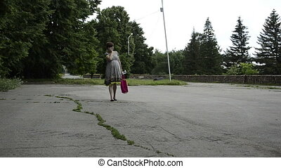 Young pregnant woman is walking