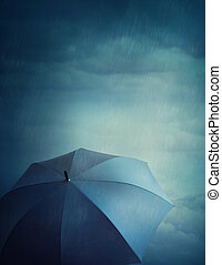 Dark clouds and umbrella - Dark stormy clouds and umbrella