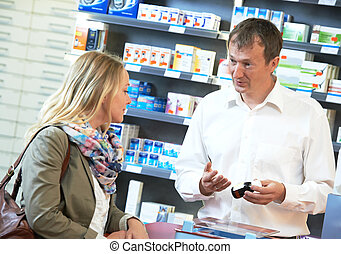 pharmacy chemist workers in drugstore - cheerful pharmacist...