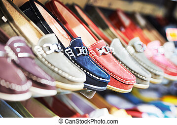Shoes in a shop - Row of slip-on shoes in a footwear shop