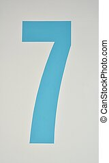 Numerical - Number seven painted in blue on a wall
