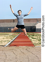 Athlete - Teen athlete during her triple jump practise