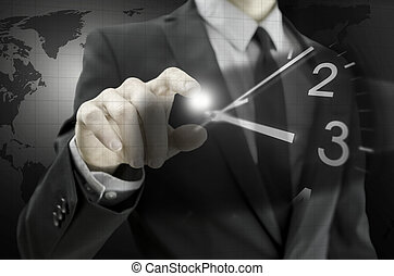 Businessman navigating virtual clock in virtual space....