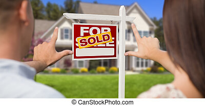 Sold For Sale Sign, House and Military Couple Framing Hands