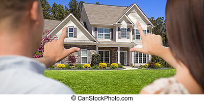 House and Military Couple Framing Hands in Front Yard.
