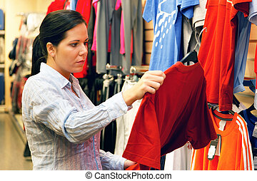 Woman in textile market - Young woman in a textile market...