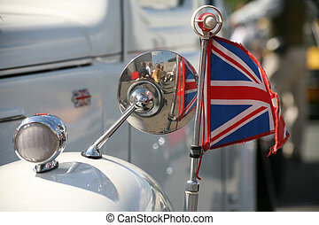 Union Jack at an old, white vintage car
