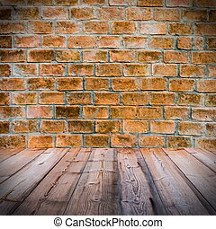 Red brick wall with wooden floor