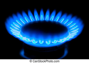flame of gas - blue flame of gas over black background
