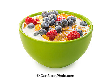 A bowl of cereals with blueberries and raspberries with milk