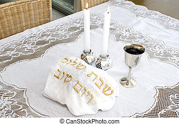 Shabbat - Jewish Holiday - Shabbat eve table with covered...