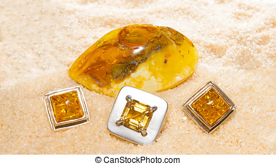 Amber cabochons set in jewllery - Amber cabochons set in...