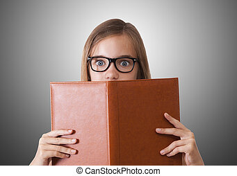 woman with open book looking at camera