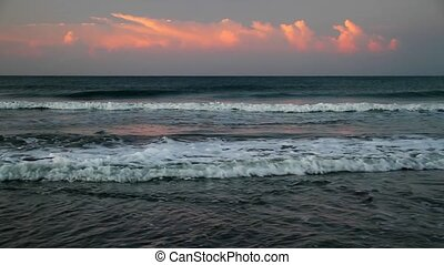 Surf and Sunrise Clouds Loop - Loop features salmon pink...