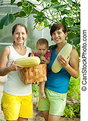 family with  harvested vegetables
