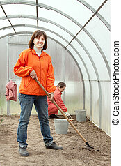 women works at hothouse