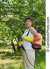 gardener working with garden spray - gardener working in...