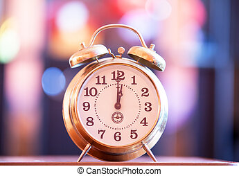 Retro clock with bokeh at background