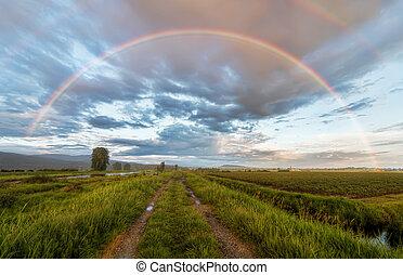 Dirt road under a beautiful rainbow - Beautiful rainbow...