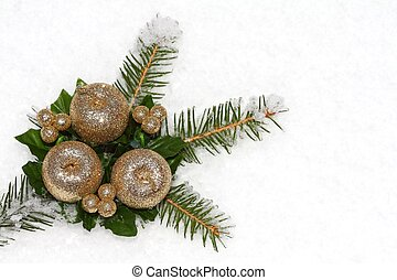 Christmas twig with decoration on white snow background with...