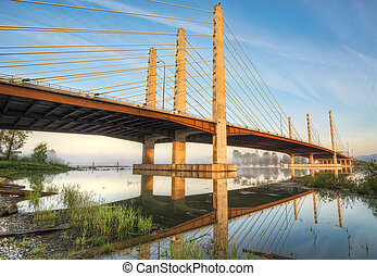 Golden Bridge With Reflection - Full reflection of a golden...