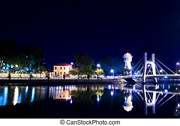 Phan Thiet Water Tower on Ca Ty River at Evening. Water...